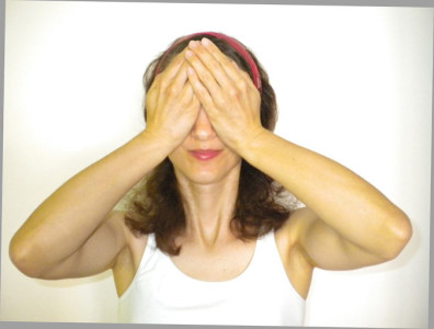 woman palming her eyes